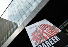 Facciata di palazzo Paolo Prodi e manifesto Career Fair